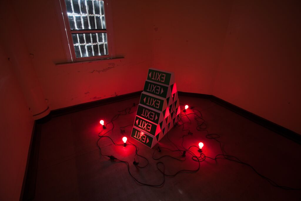 Sign 2   2015  exit signs, red lights  Photography Alycia Bennett