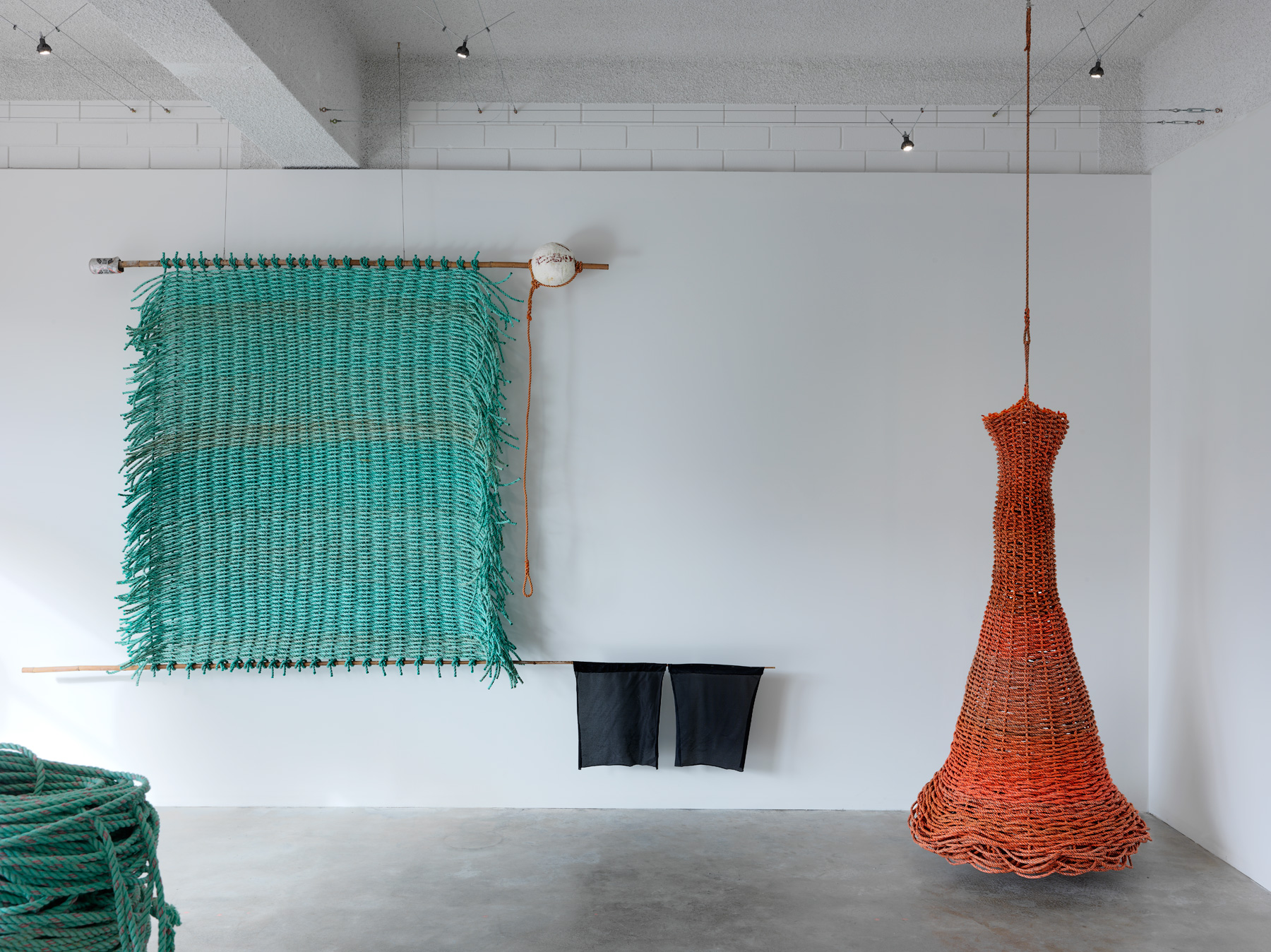 Deep Blue  (left) &  Snagged  (right)  2016  Discarded bamboo, nylon, rope, lead, aluminum can and float   Deep Blue  - 170 x 315 x 20cm   Snagged  - 187 x 80 x 80cm  photographer Grant Hancock
