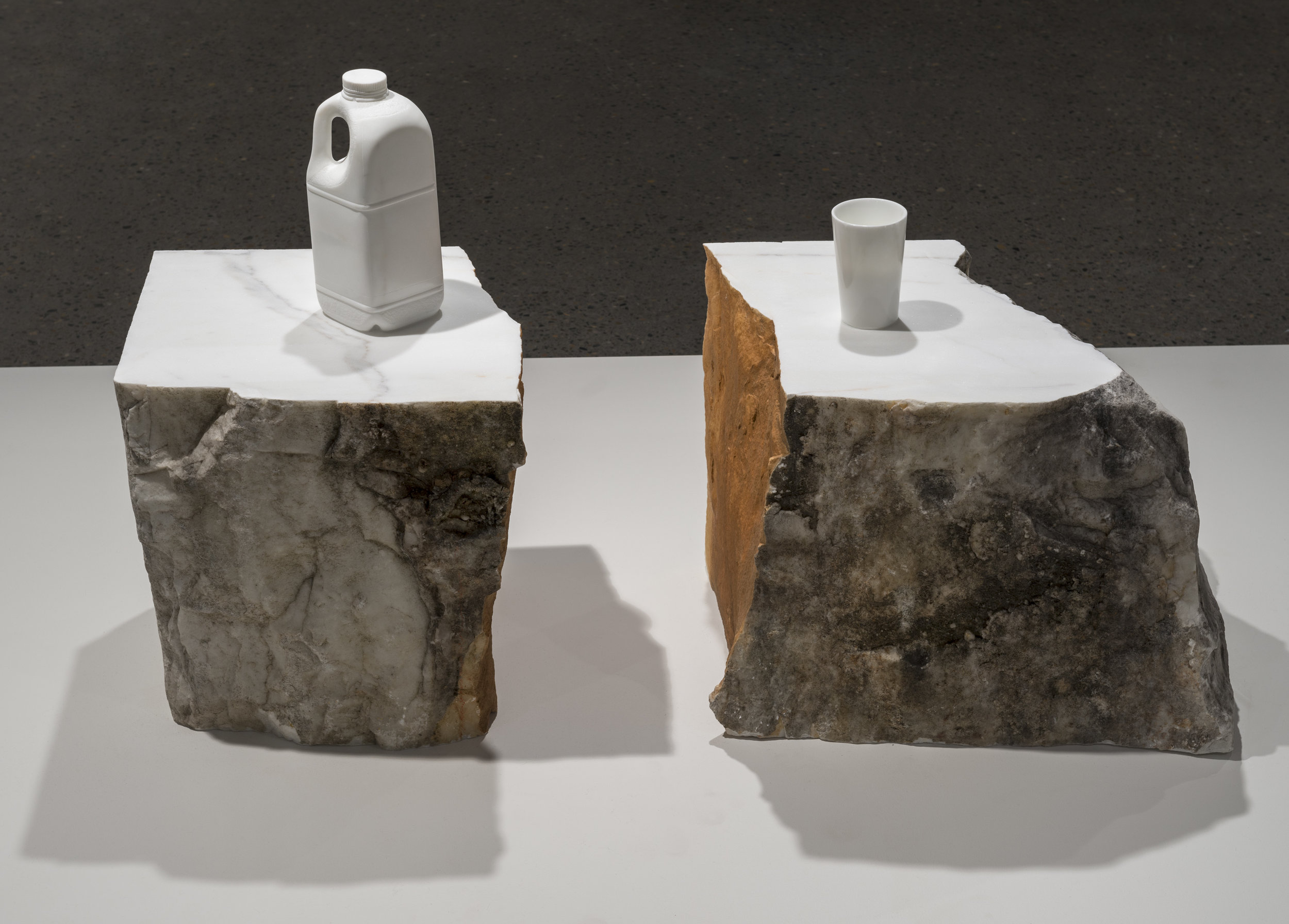 Half   2013  Statuario marble, 315 Duralex glasses and dust from the carving  Two pieces: 56 x 39 x 55 cm and 73 x 39 x 40cm