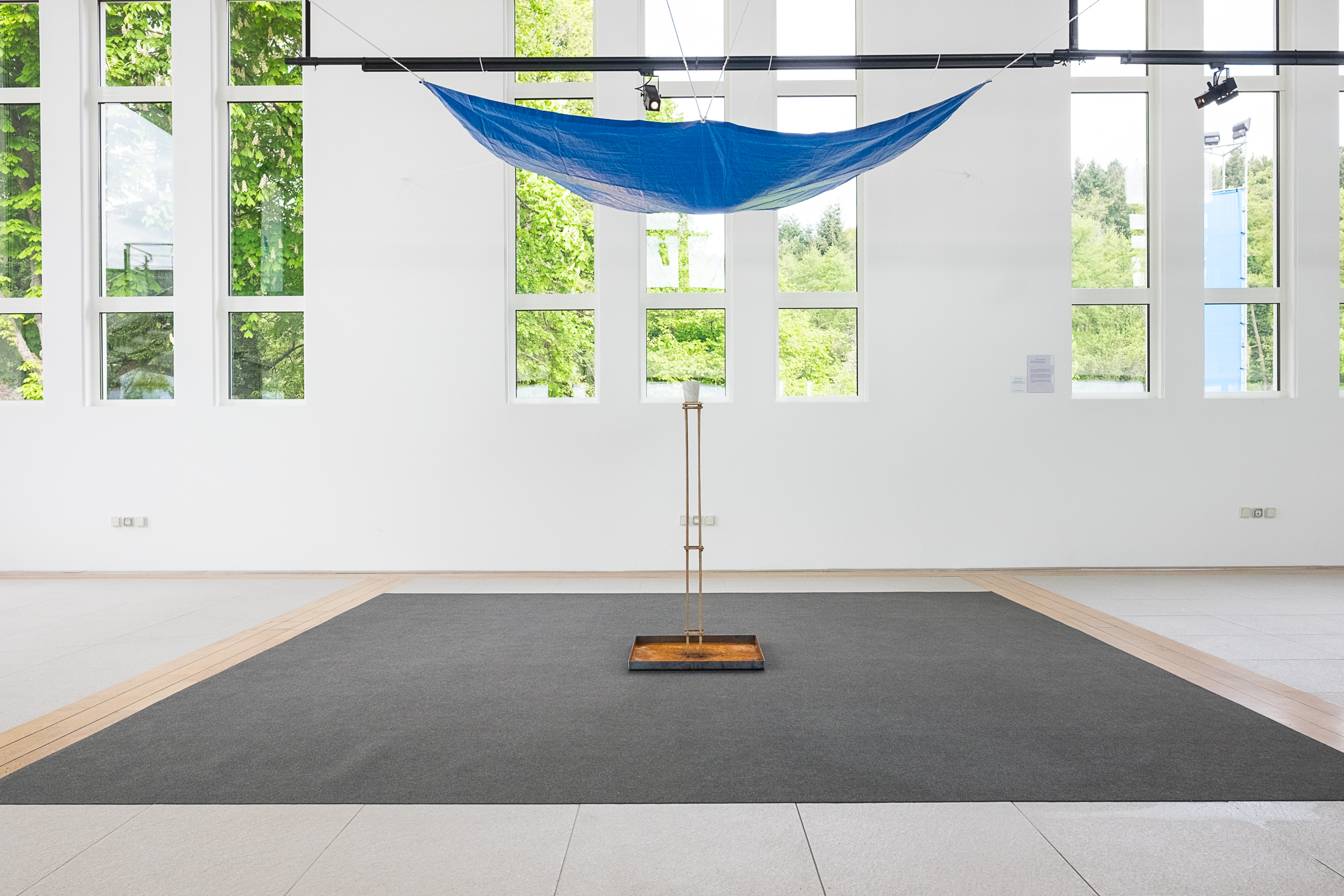 Deluge in a Cup   2015 Bianca Carrara, stainless steel tray, tarp, water, rope, Tasmanian oak stand Dimensions variable