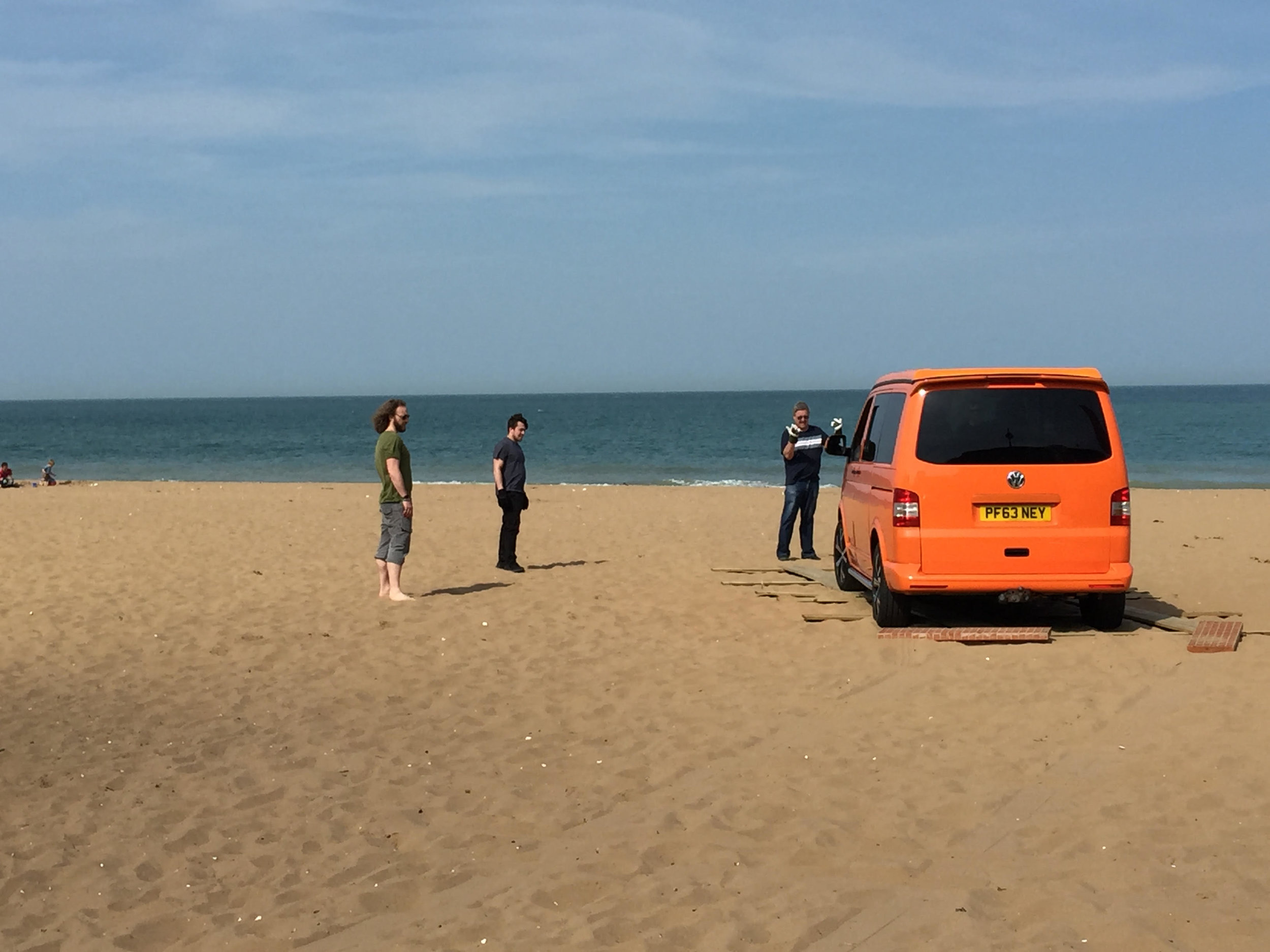 Orange camper van on Joss Bay beach.jpg