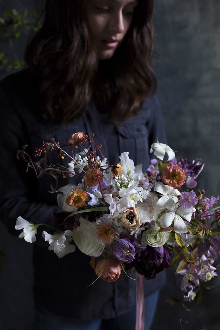 The beautiful Hannah, of  Aelisabet Flowers  in Yorkshire, holds her bouquet of tulips, ranunculus, spiraea, clematis, geraniums, geum and heuchera.
