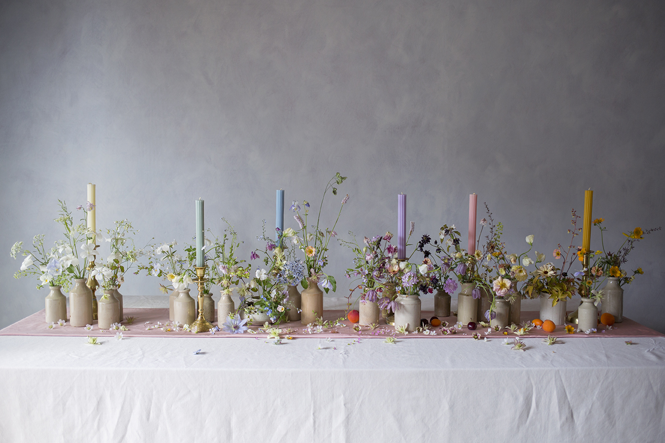 Gradations of colour - grouping flowers, fruit and candles by colour is an effective and fun way of achieving a multicolour effect. An ombre of white through cream, sage, blue, lilac, rose and tangerine.