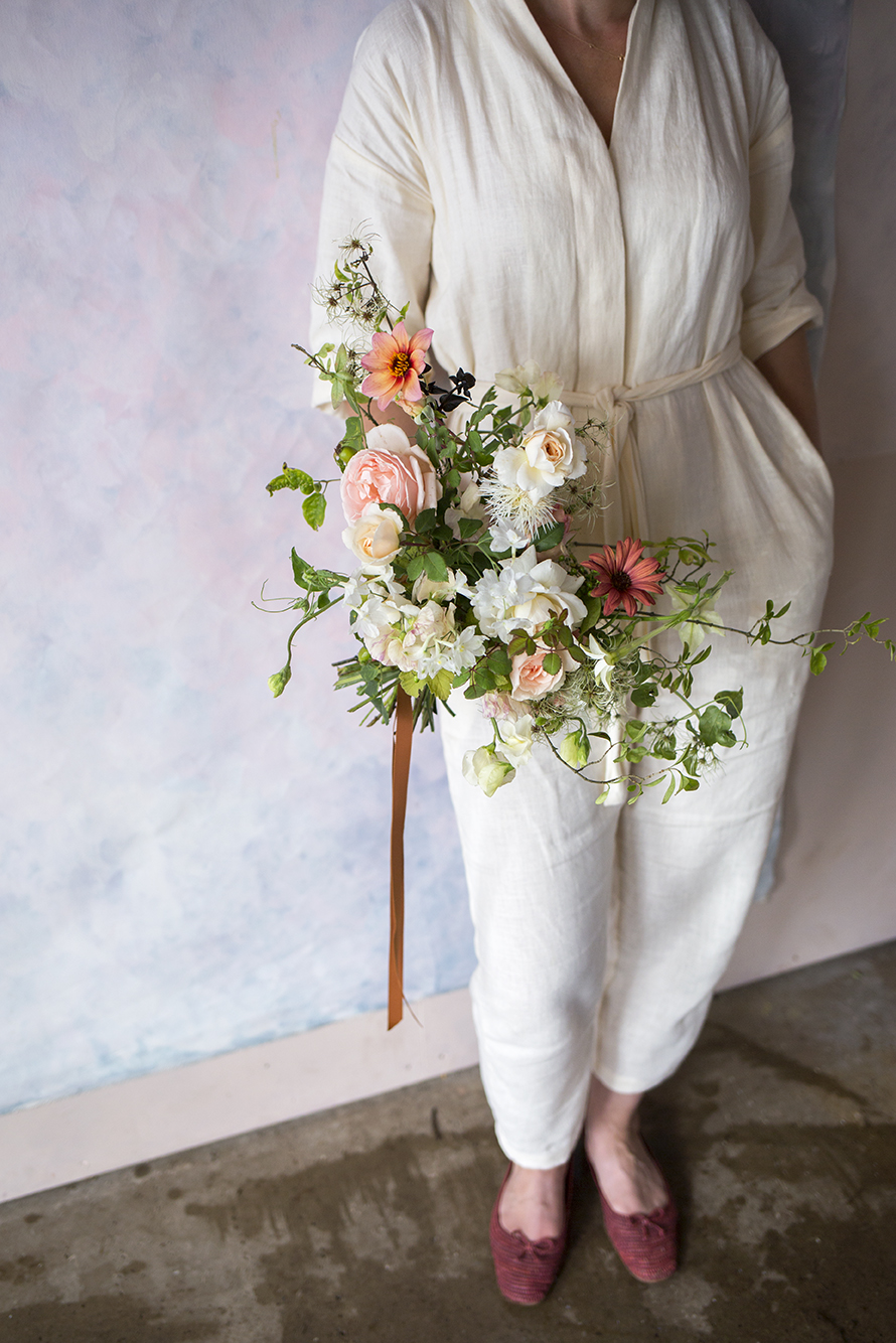 A late-summer bouquet in a palette of fresh green and white, cream and gingery pinks with a tobacco-brown grosgrain ribbon.