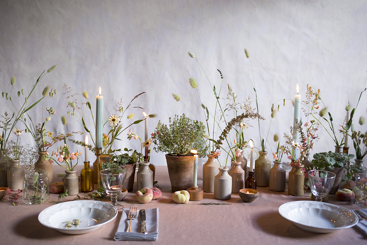 A tablescape of terracotta pots, plants and grasses made during a group workshop at Aesme Flower Studio