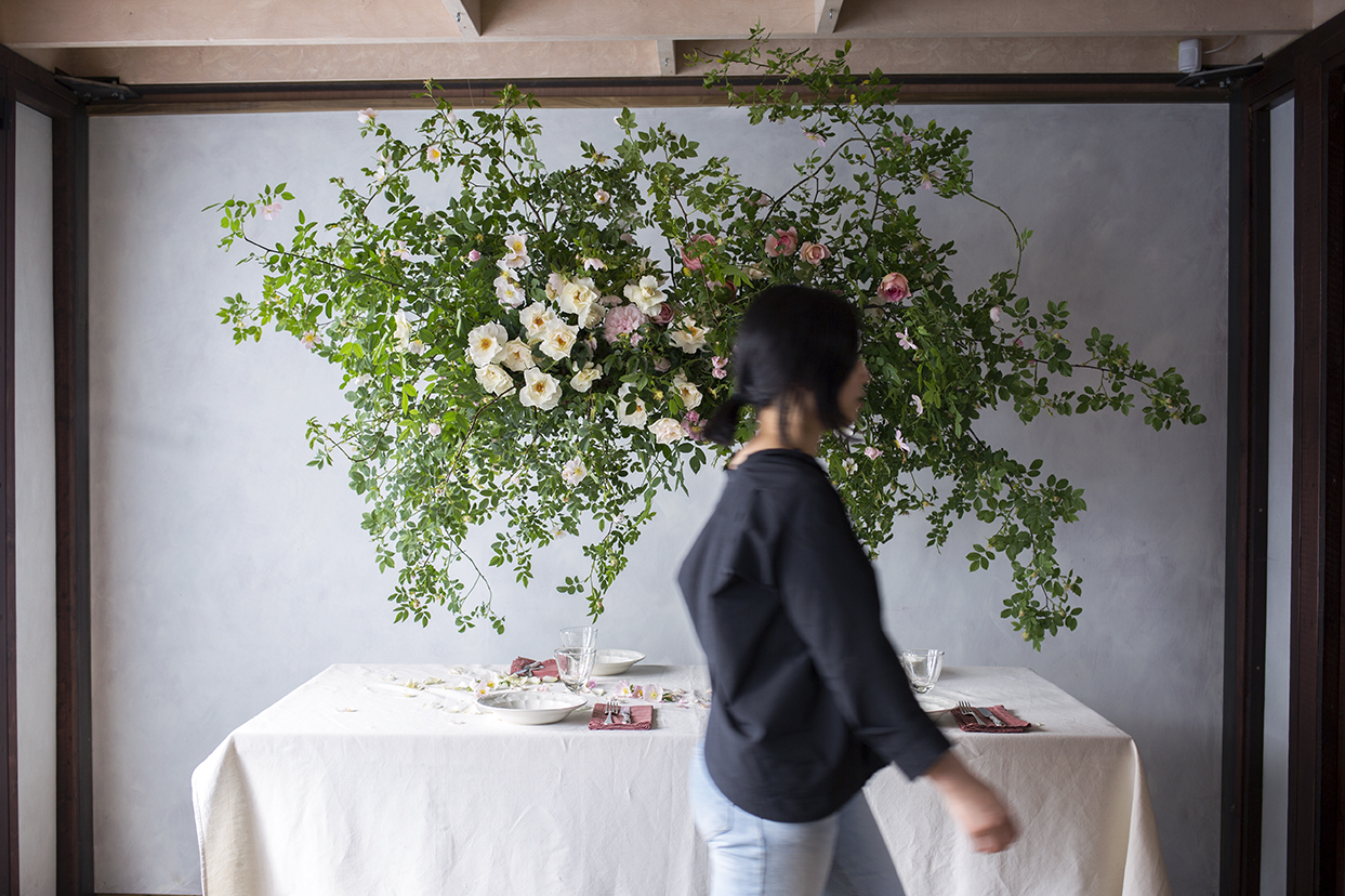 A hanging installation of wild dog rose and scented garden roses