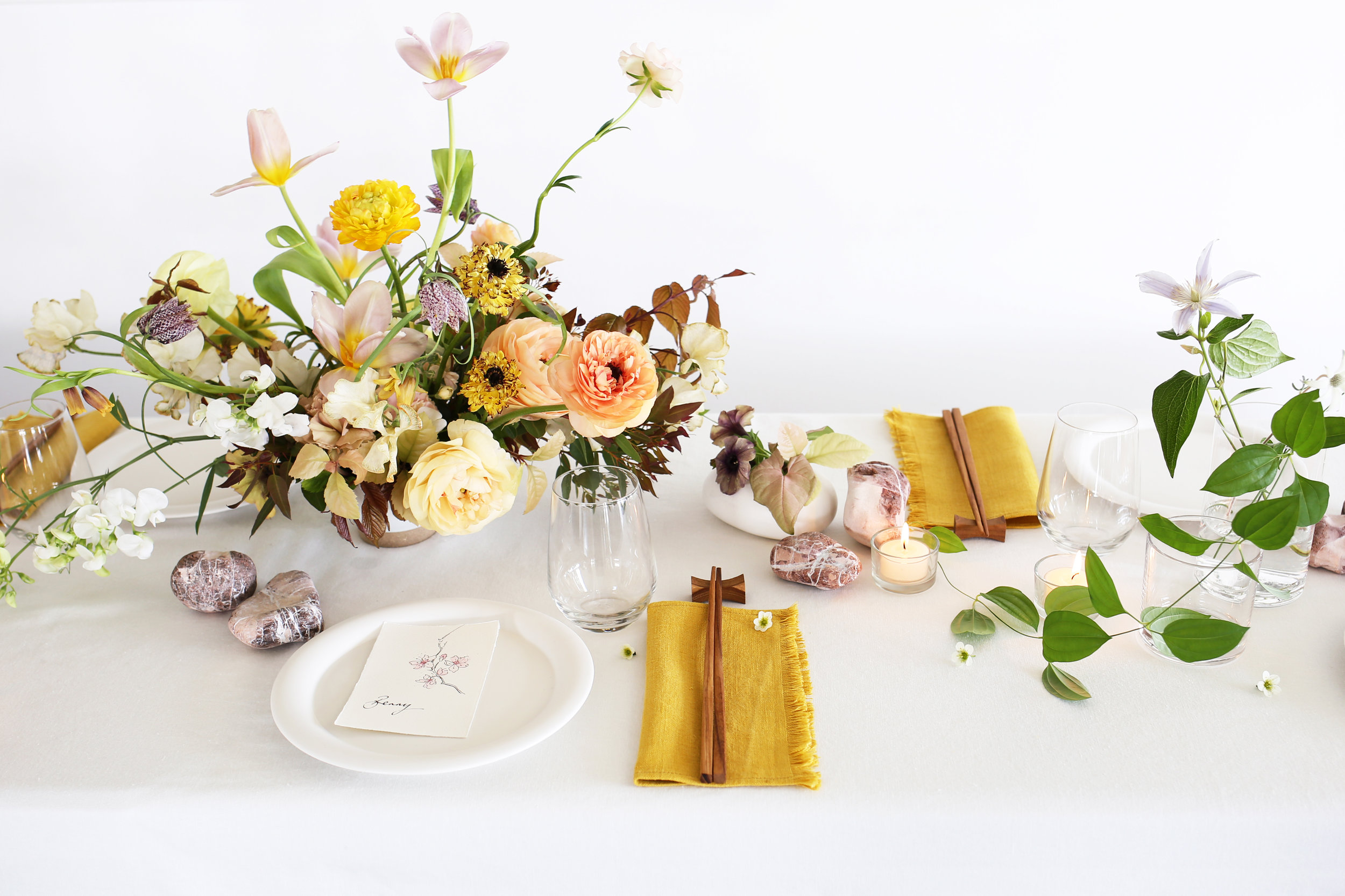 Flower School | table styling & props: beach pebbles, shells, intricate vines and ochre linen