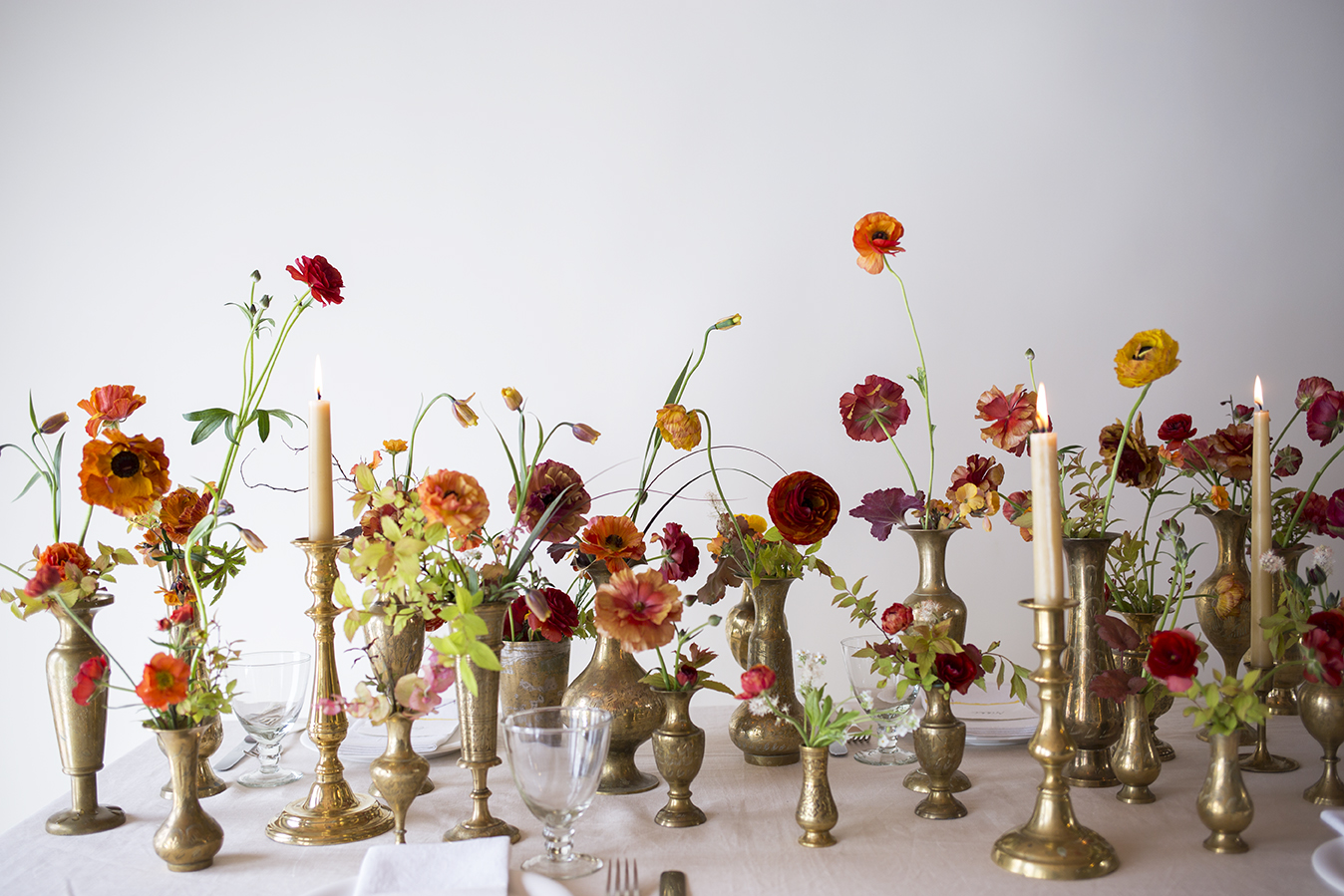Flower School | Table styling group workshop: antique Indian brass vessels and florals in a palette of red, gold and lime