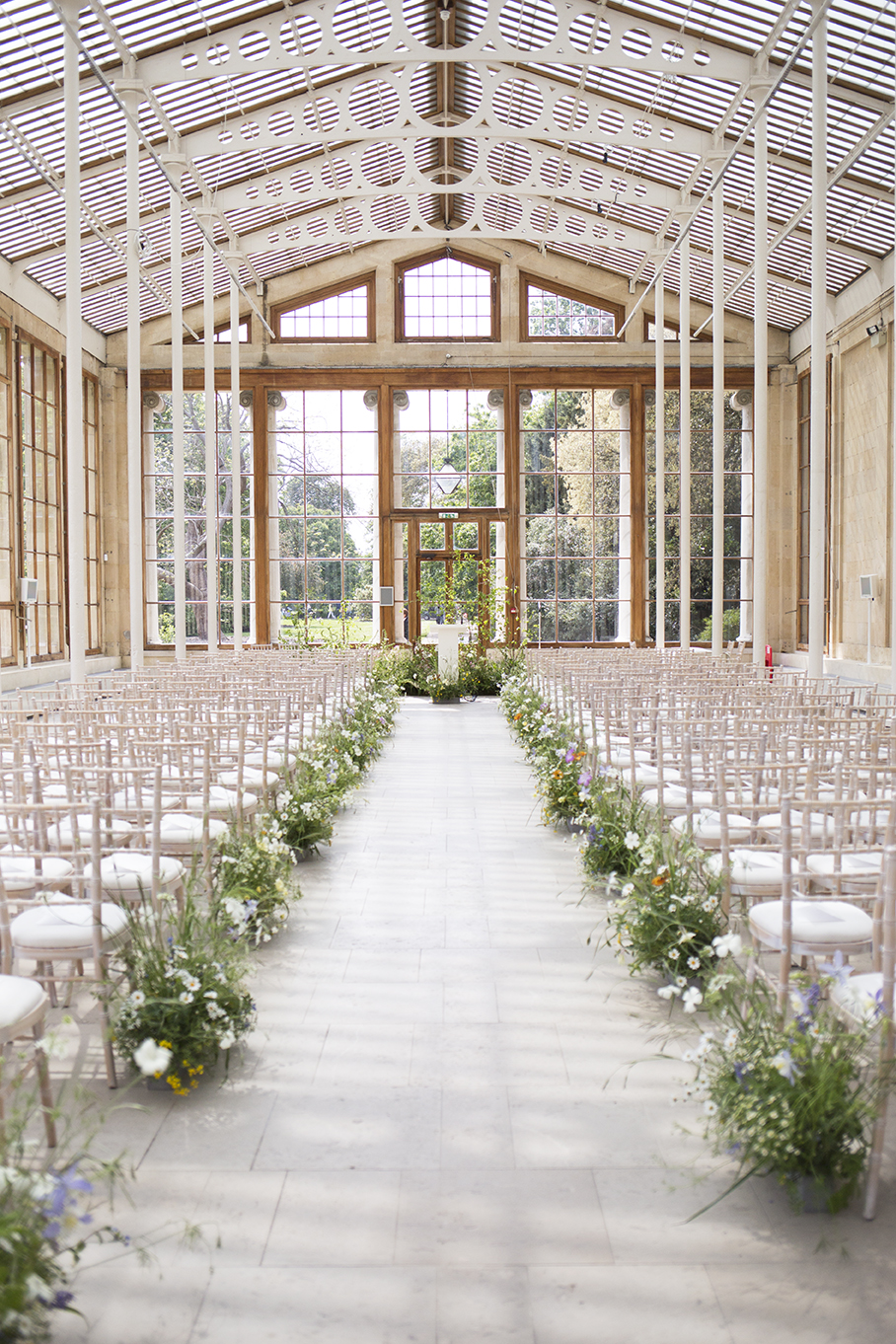Alpine-inspired aisle arrangements for Hannah & Gianluca in the  Nash Conservatory  at  Kew Gardens
