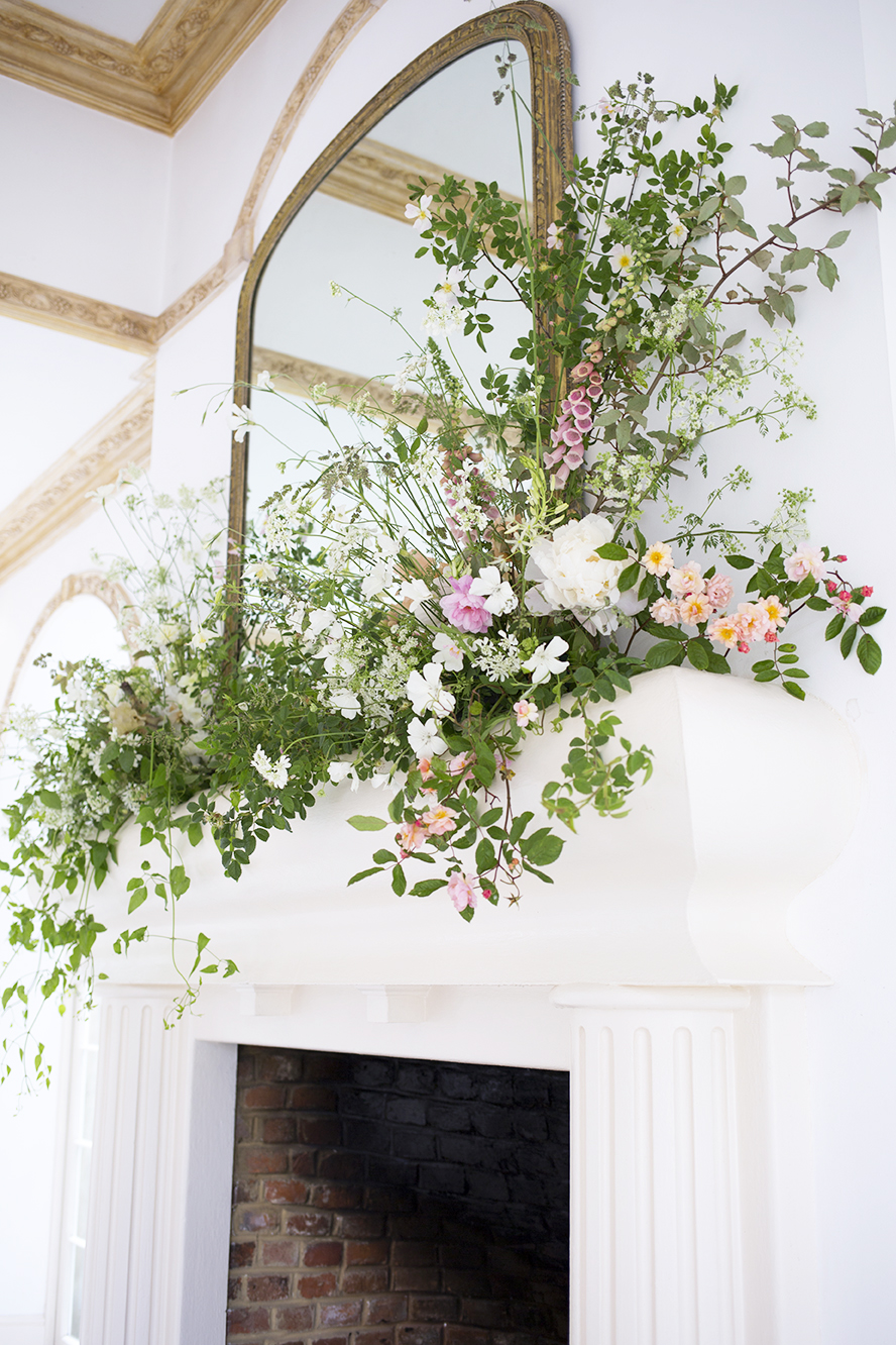 An organic mantel installation for a wedding at  Northbrook Park , Surrey in late May included wild dog rose and wisps of cow parsley