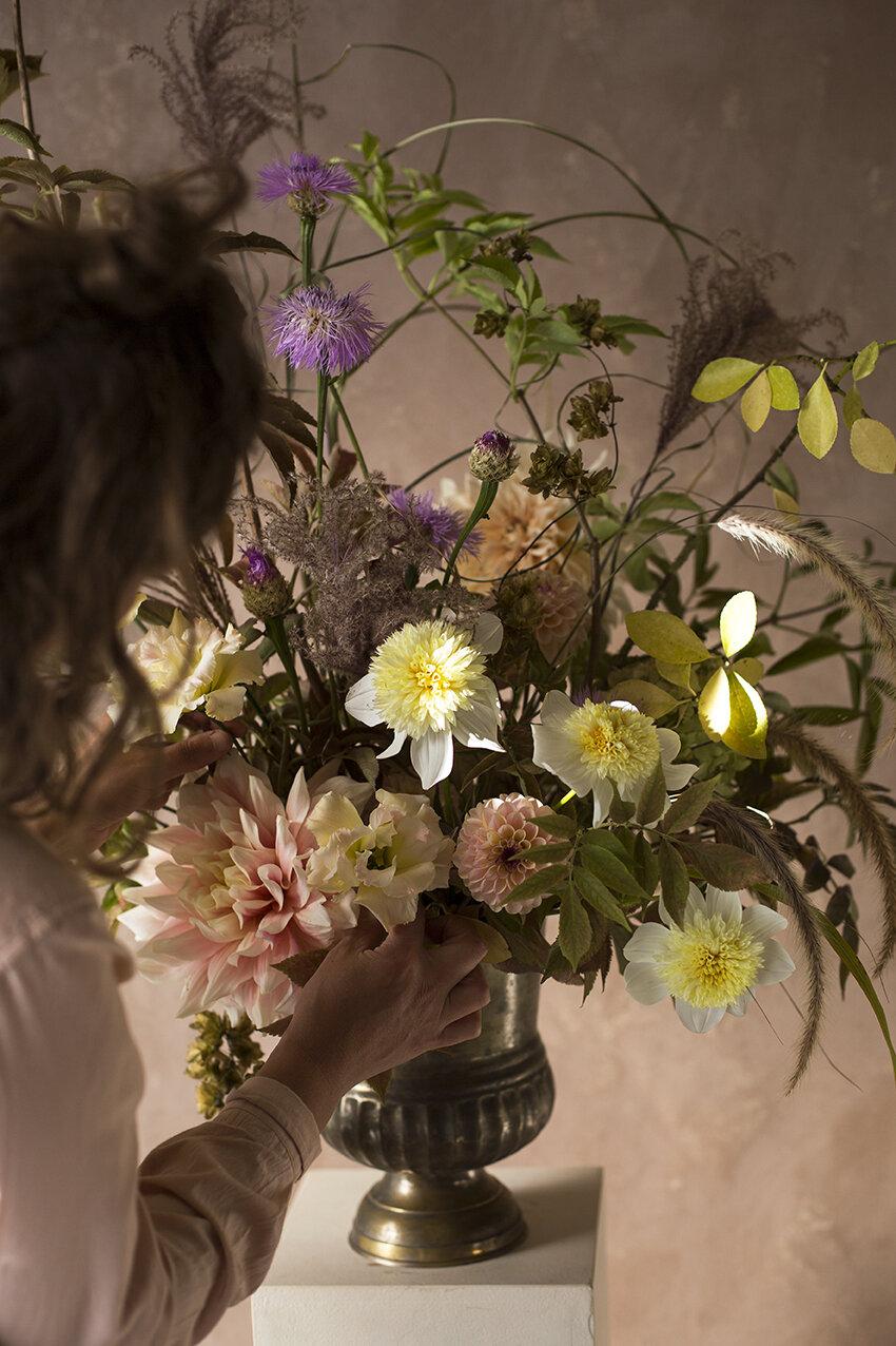 Urn of dahlias, miscanthus, lisianthus, centaurea & autumn leaves
