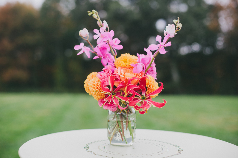orange-pink-floral-arrangement-ranunculus-orchids