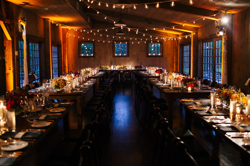 barn-wedding-string-lights-rustic-chic-farm-tables-uplighting