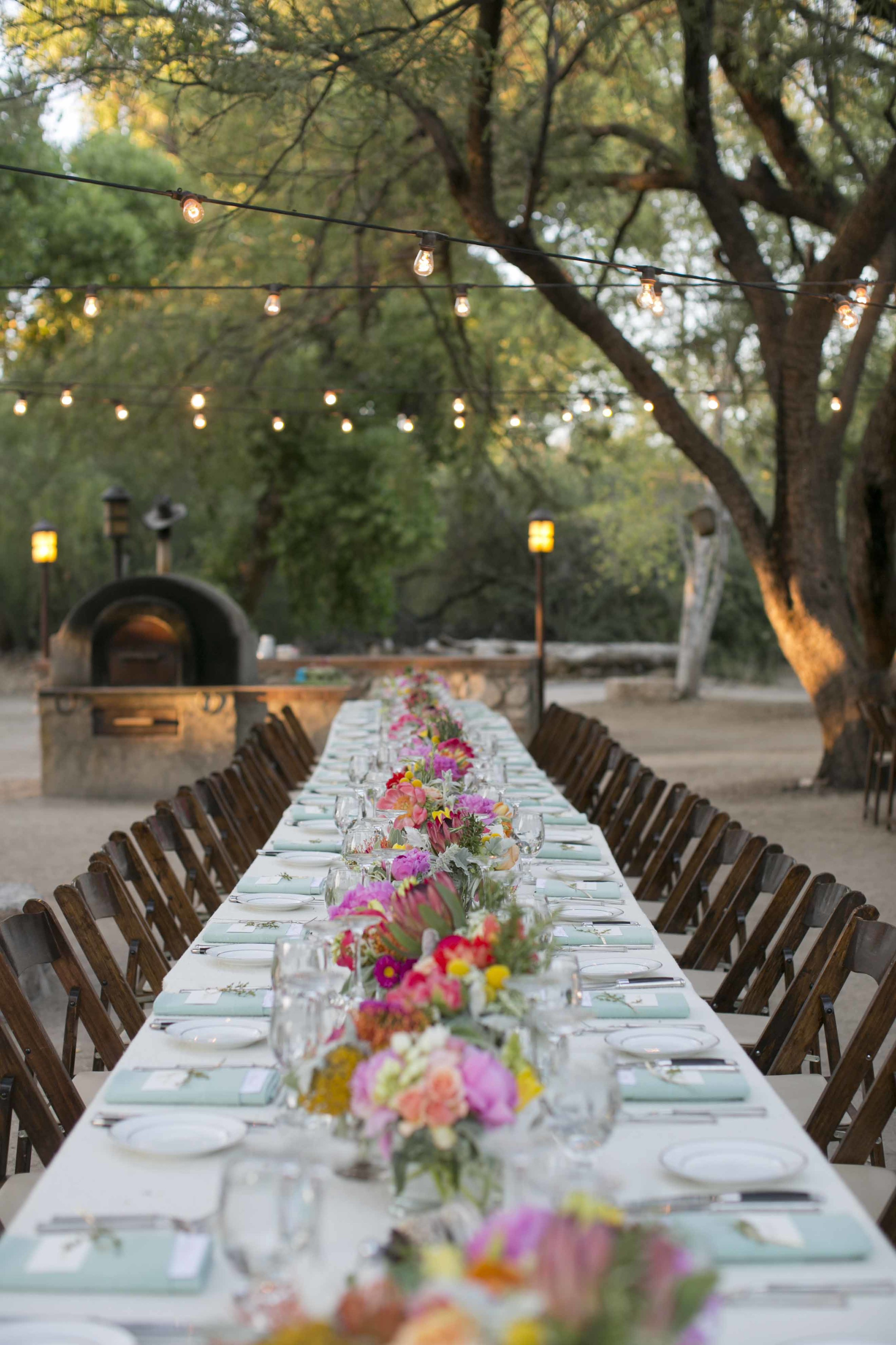 long-tables-wedding-desert-string-lights-peach-chic