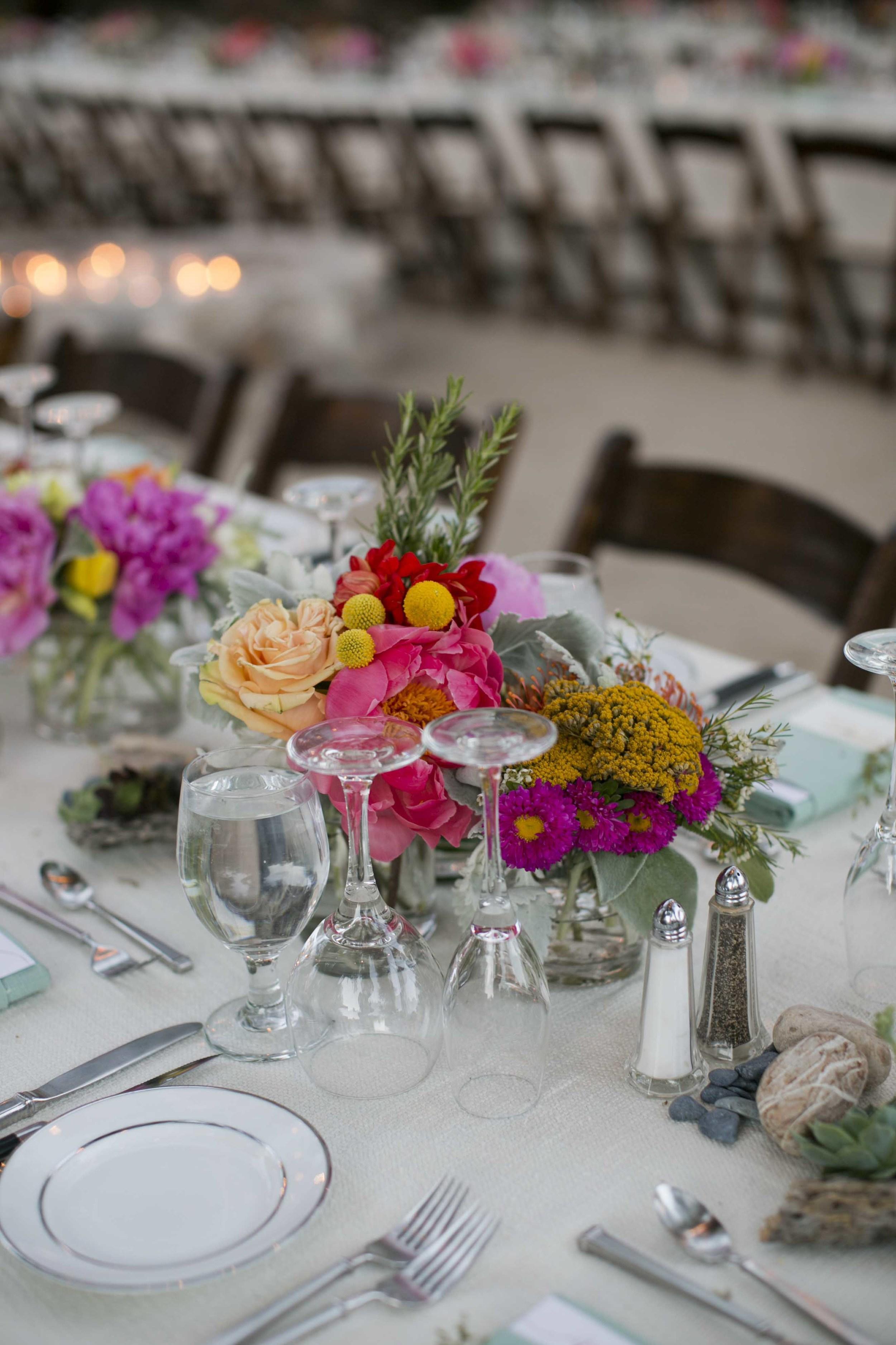 magenta-pink-yellow-floral-centerpiece-wedding-desert