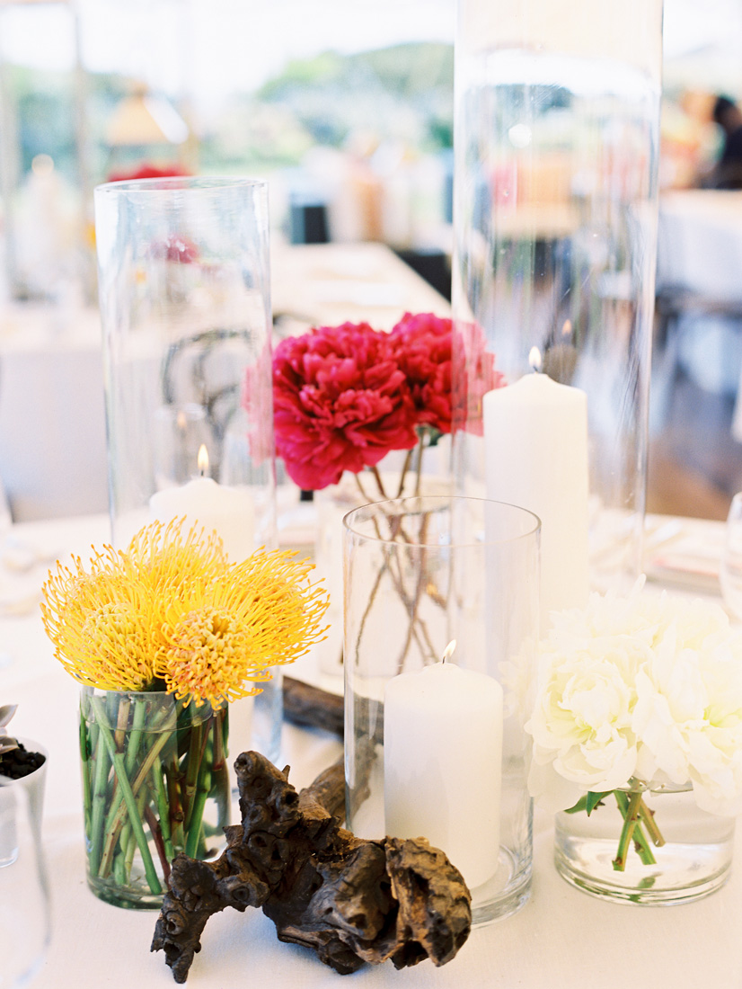 clean-simple-wedding-centerpiece-driftwood-protea-hurricane