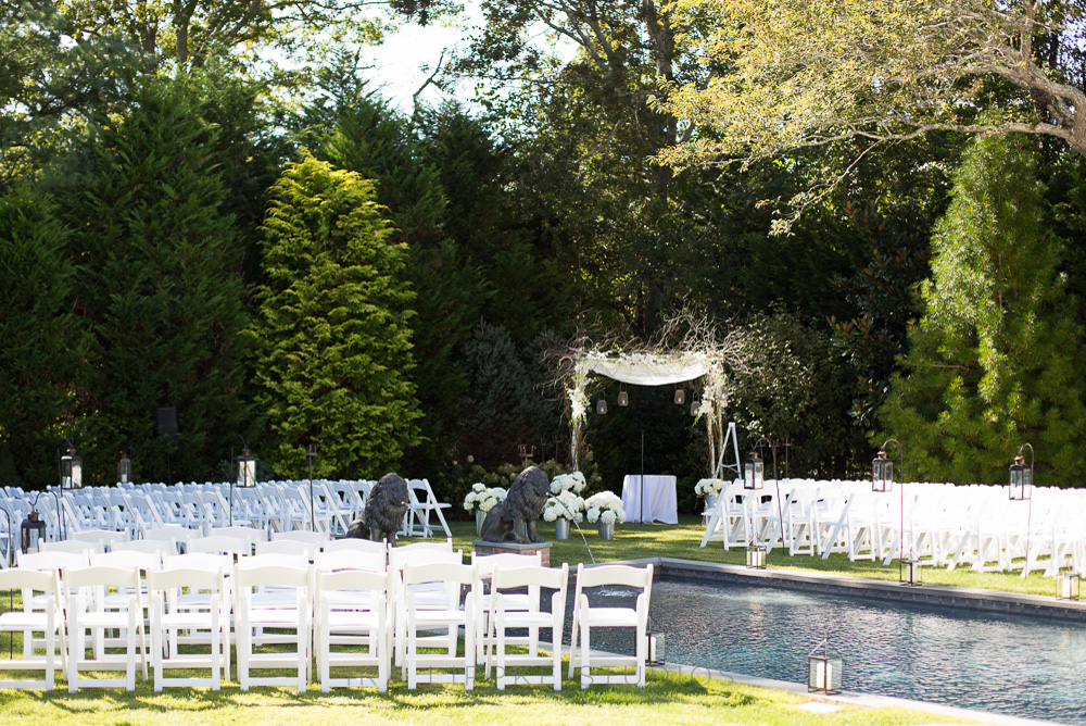 outdoor-ceremony-set-up-backyard-chuppah-branch-white