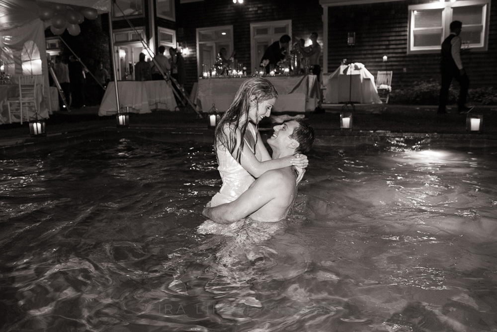 bride-groom-pool-party-kissing-bw