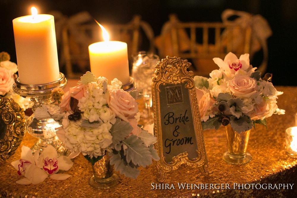 wedding-centerpiece-pillar-candles-white-flowers-sophisticated-glamorous