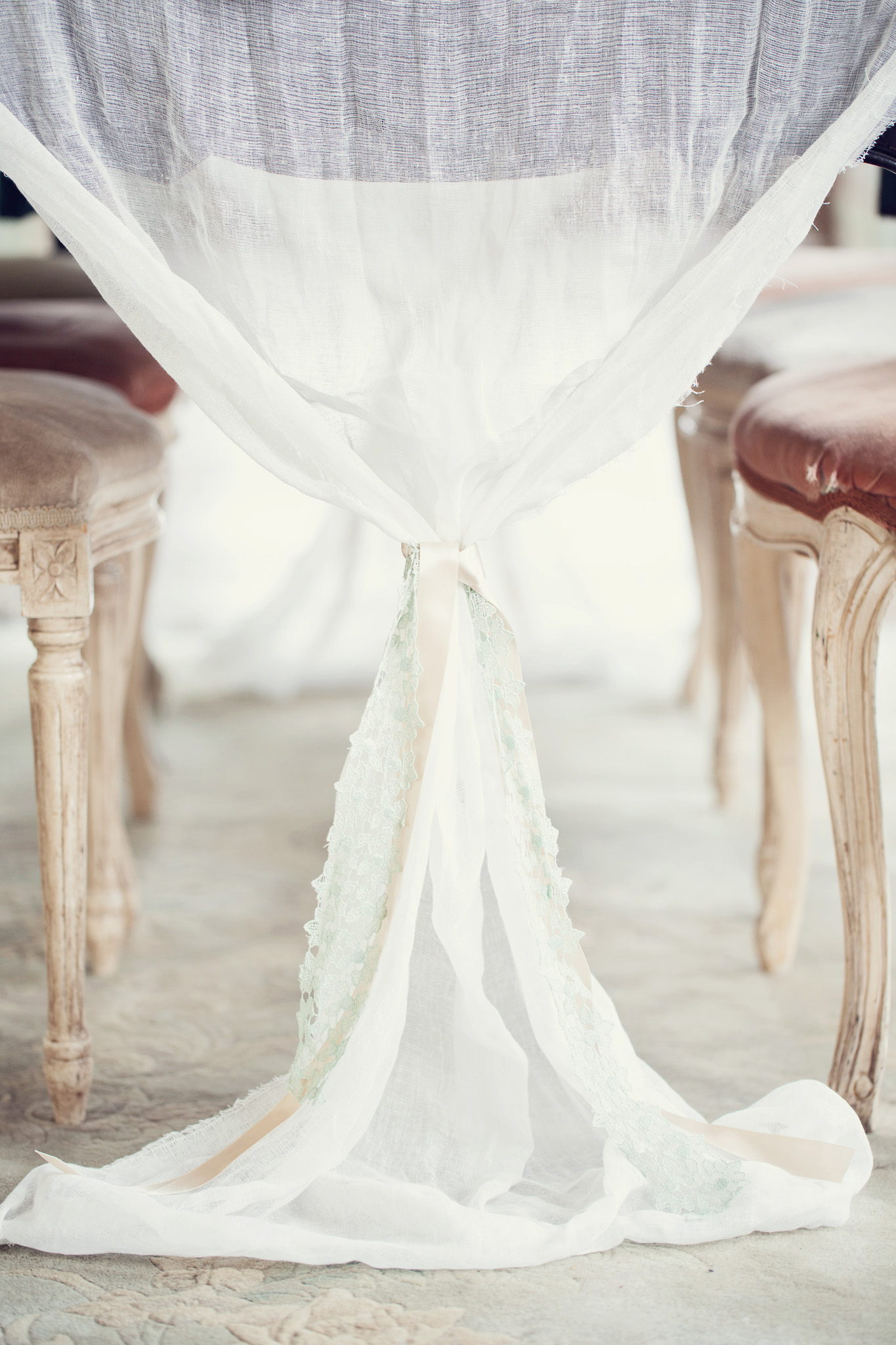 cheesecloth-table-runner-draping-off-table