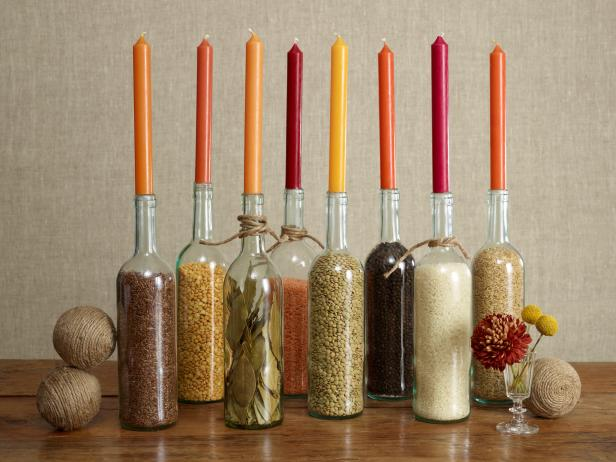 thanksgiving-fall-centerpiece-decorating-candles-wine-bottles-grains-orange-yellow-red