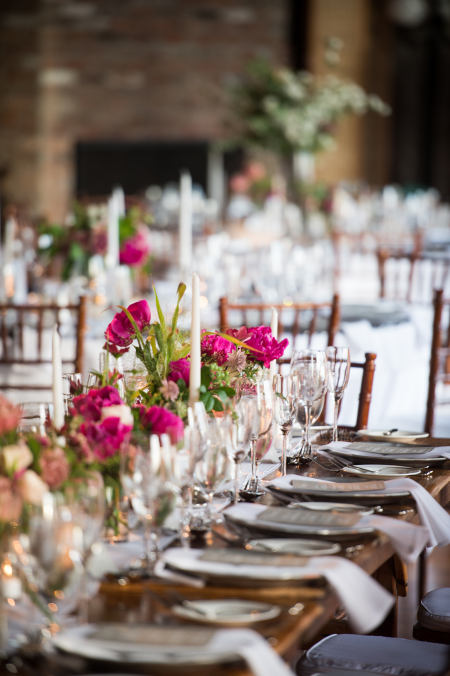 liberty-warehouse-wedding-long-wood-tables-magenta-centerpieces
