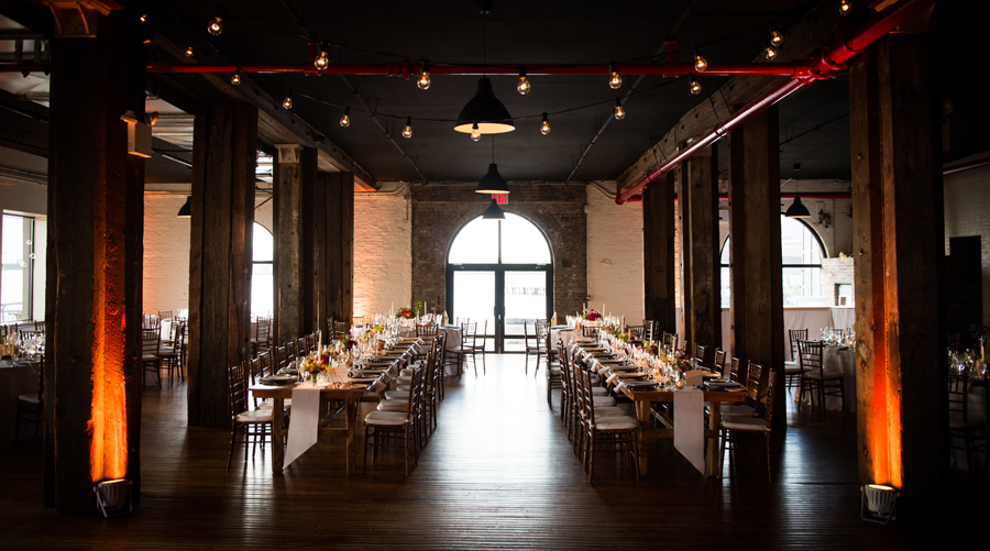 liberty-warehouse-wedding-pegasus-lighting-edison-bulbs-bistro-string-lights-long-wood-tables