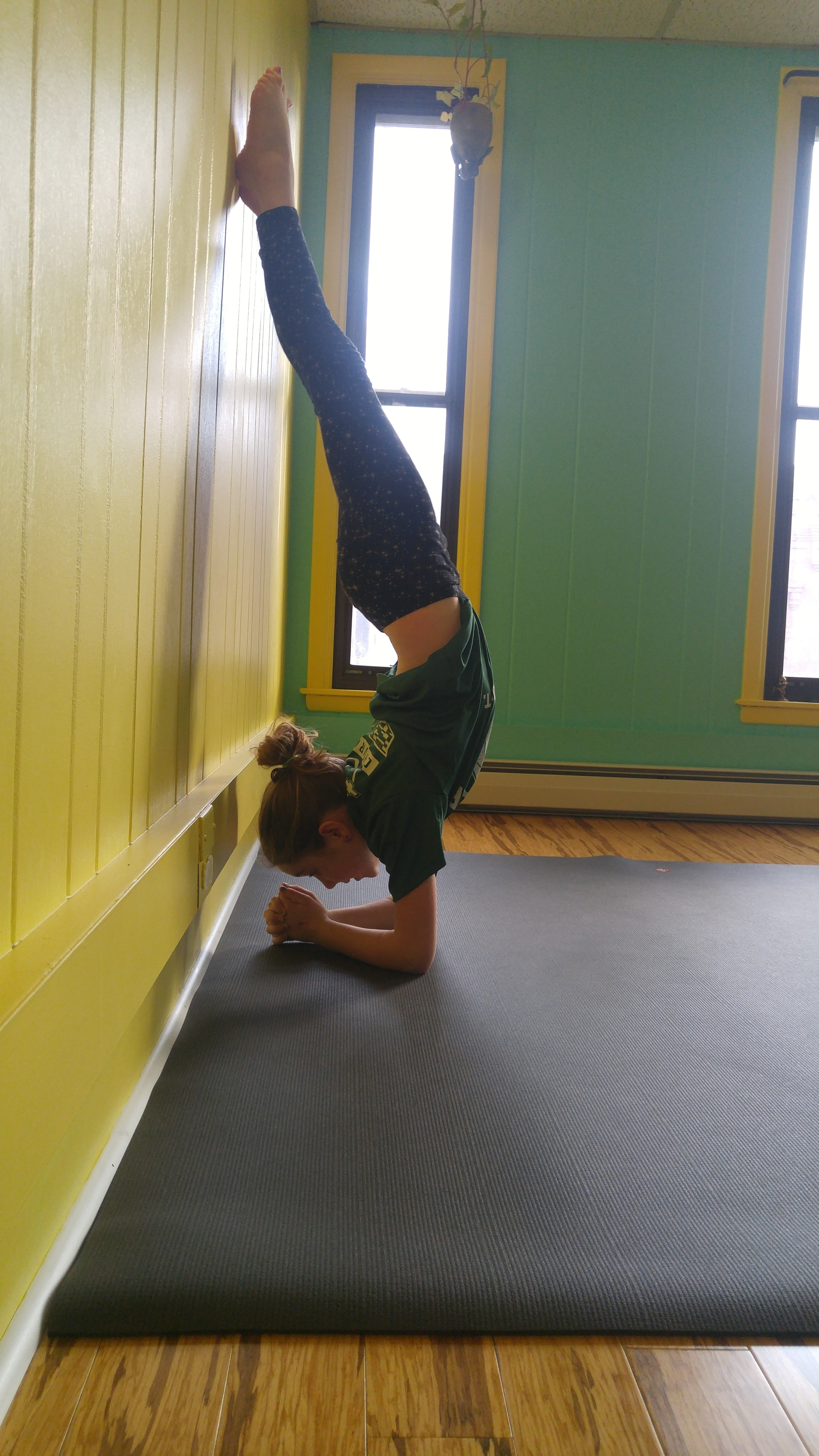 Meala: age 10     Favorite postures: Forearm Stand, Crow