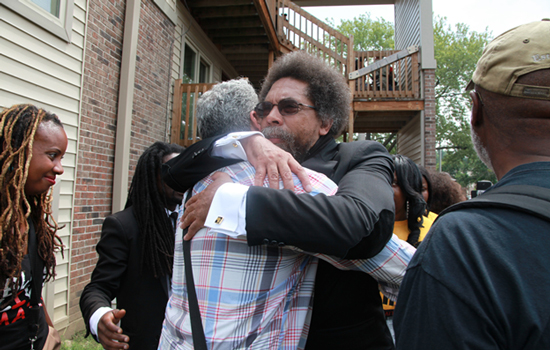 Palestinian father Siam Nowara embraces public intellectual Cornel West following a commemoration event on the year anniversary and at the site where 18-year old Michael Brown Jr. was killed by police. (Photo taken by Carlton Mackey)