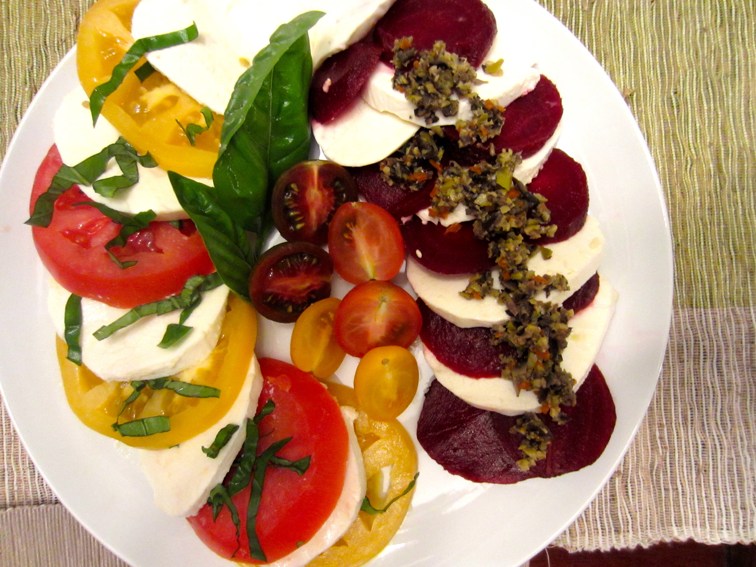 Caprese Salad with tomatoes, topped with Olive Tapenda