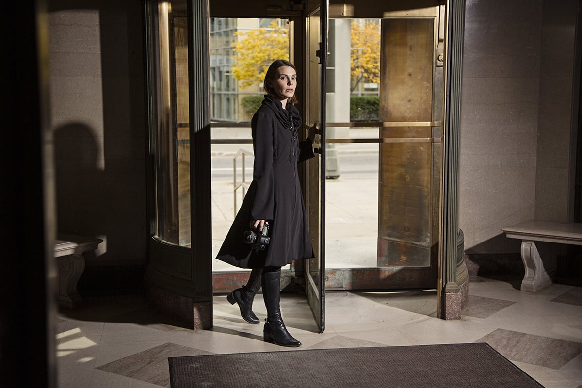 Victoria modeling a black Opera Coat for CUREiosities in the Skillman Library, Detroit.