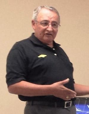 Col. John Telles, Director