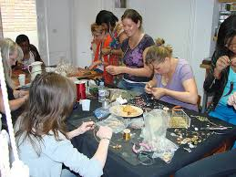 Some happy people here designing their own jewellery at Sam's Workshop day