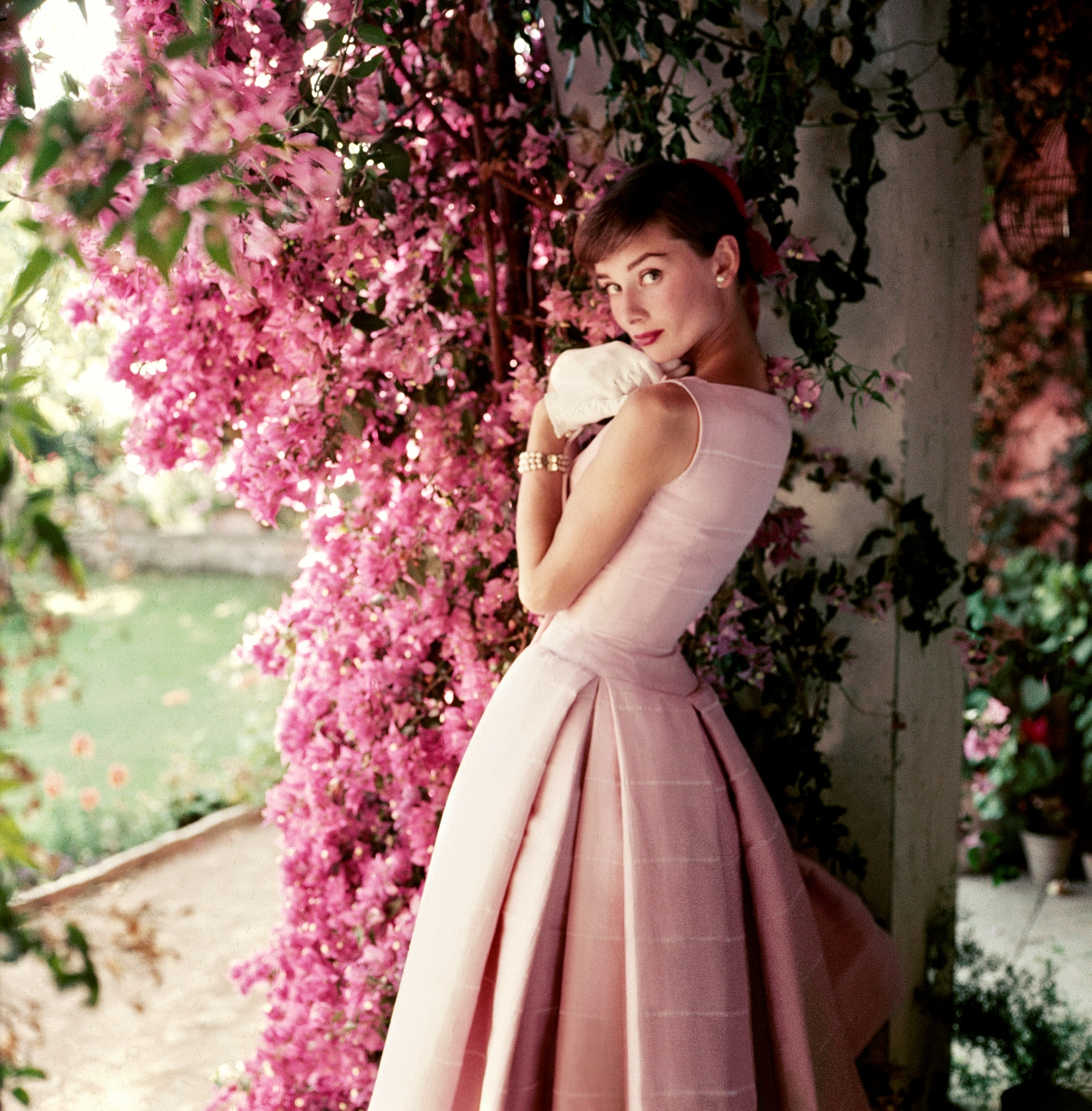 Audrey Hepburn photographed wearing Givenchy by Norman Parkinson, 1955 © Norman Parkinson Ltd/Courtesy Norman Parkinson Archive. Used with permission from The National Portrait Gallery.
