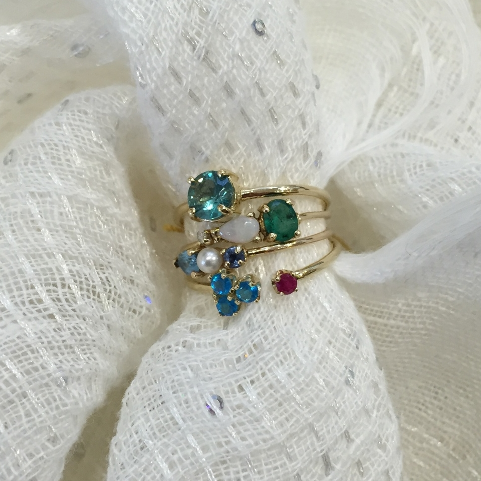 Stackable rings that she can change with her outfit and her mood.  Loren Stewart 14k Gold and Gem Stone Rings