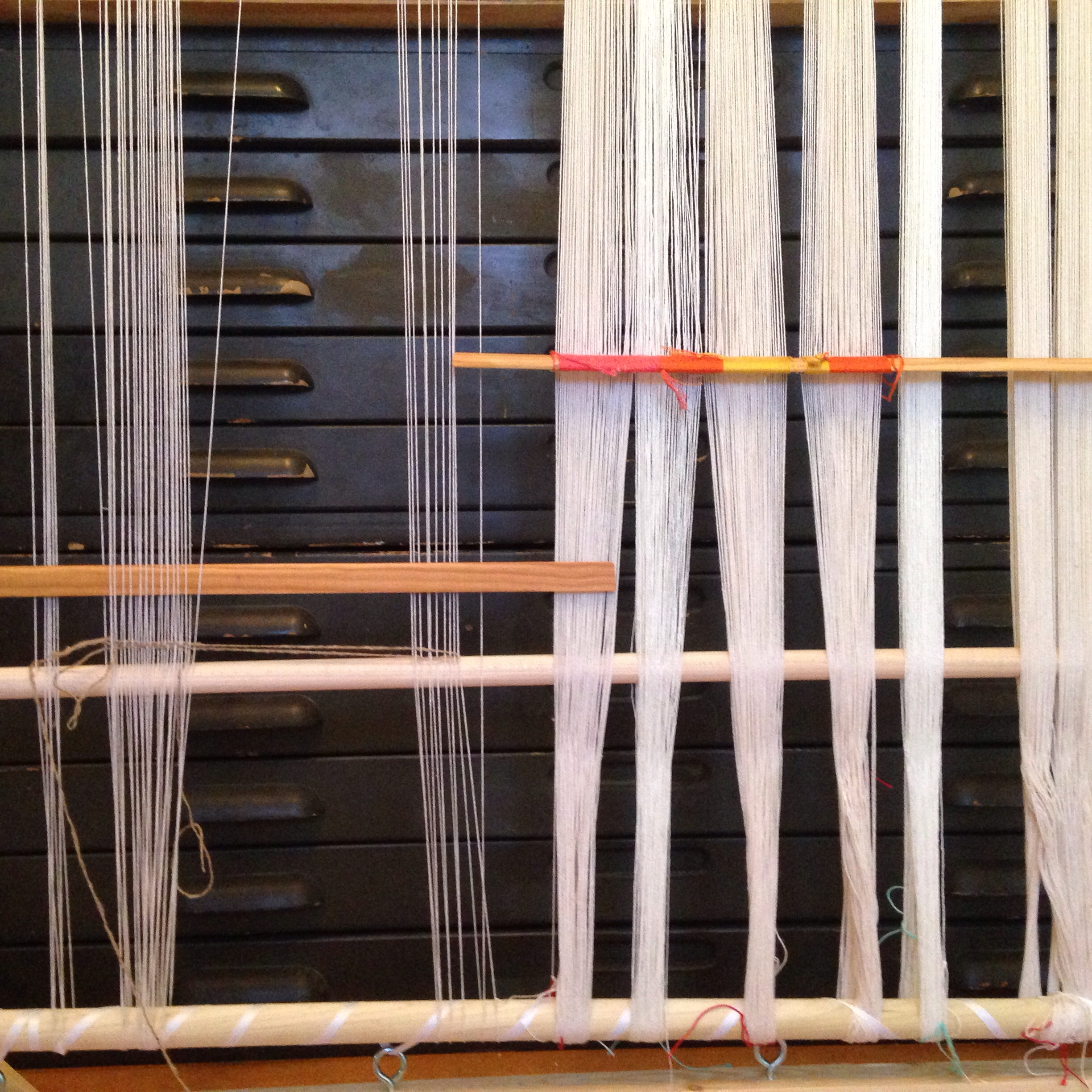 What I learned: the warp on the right, with an intense thread count, is best suited for a floor loom; the warp on the left is better suited for a tapestry loom.
