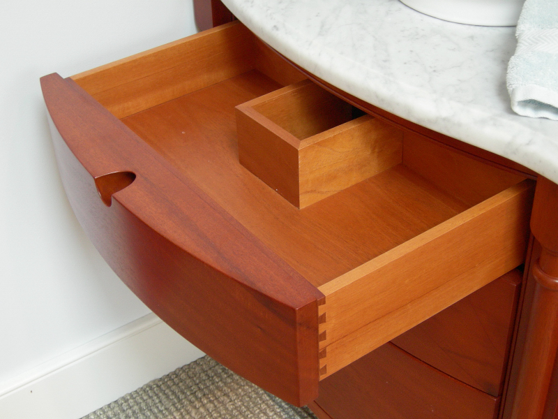 Custom designed center drawer maximizes use of space