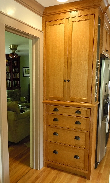 Pantry cabinet eliminates dead space on side of refrigerator