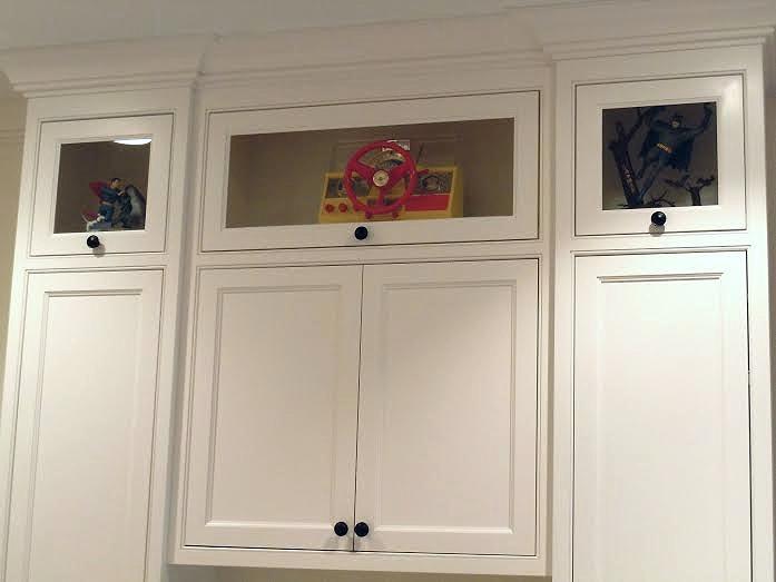 Upper display cabinets in desk unit