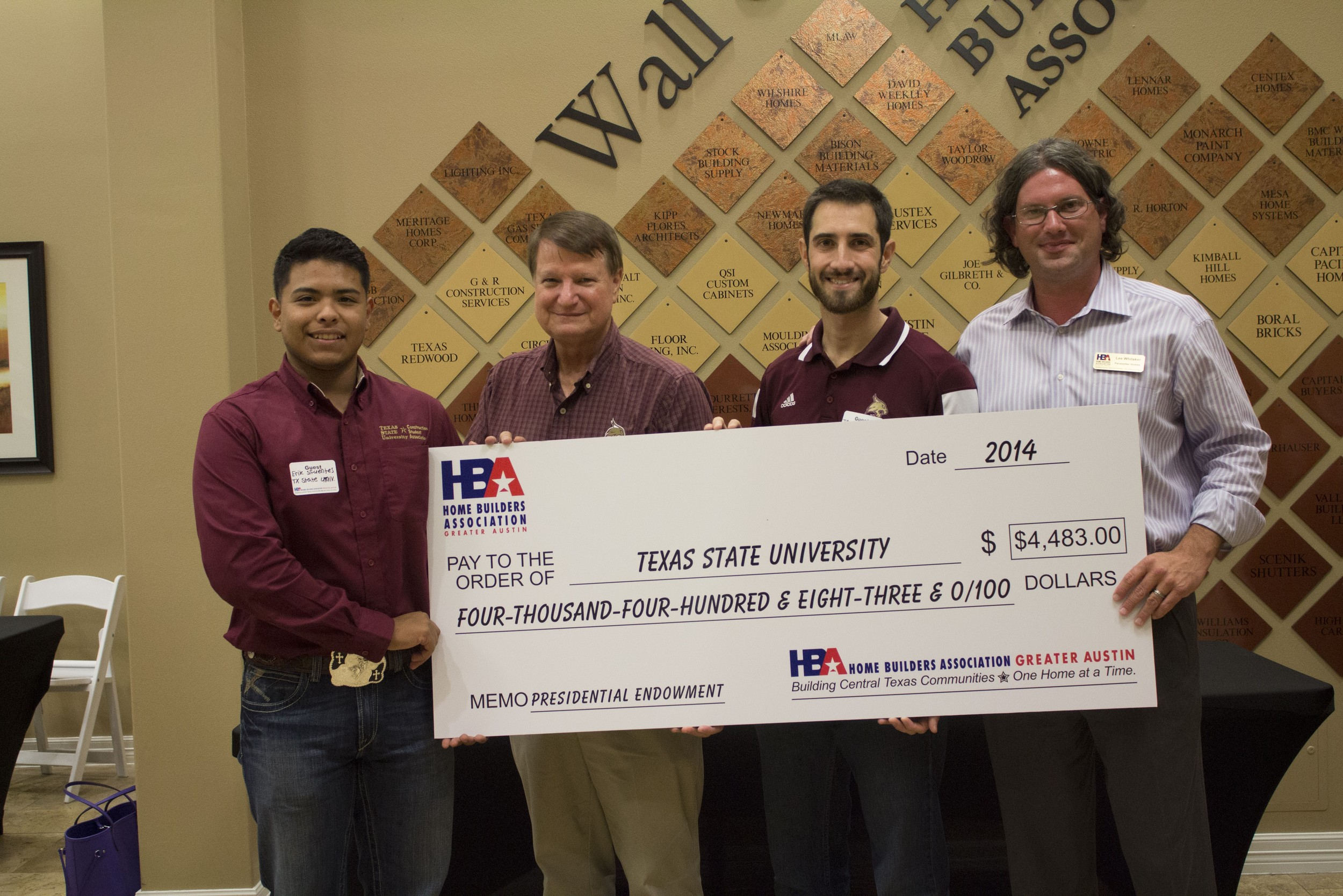 Lee Whitaker presents a check to Dr. Gary Winek (Construction Program Coordinator), Erik Sifuentes, and James Holmes on September 24th.