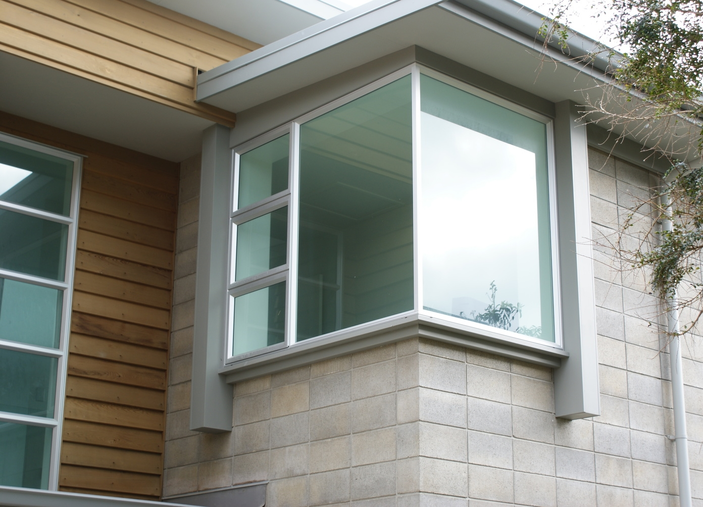 Stack bonded structural masonry, cedar weatherboard and bespoke detailing.