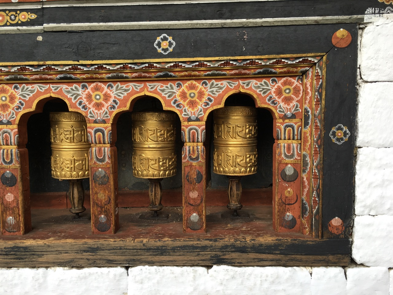 Prayer wheels. People turn these as they walk past to reveal all of the prayer written on them. The wheel often strike a bell as they are turned.