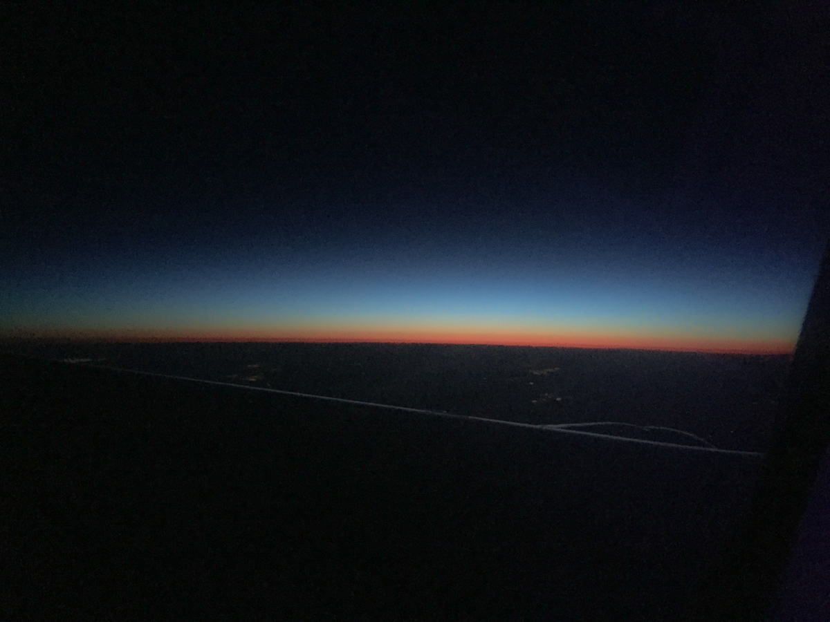 I love the view of light bending over the horizon at sunrise!