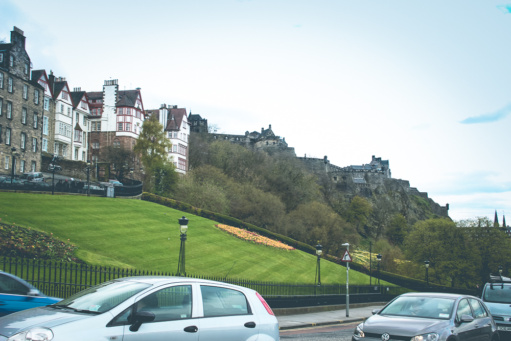 Heading up the Old Town face of the ravine, with the Edinburgh Castle perched atop the cliffs.