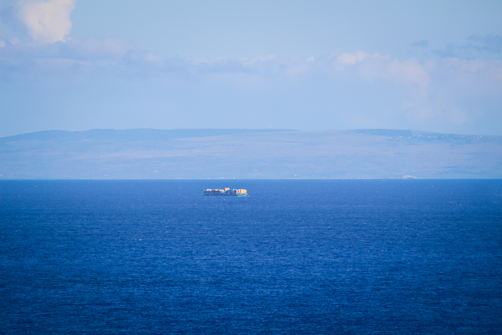 A shipping vessel in between Oahu and Moloka'i.