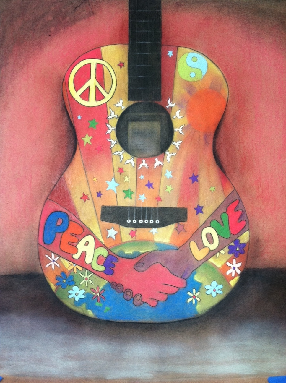 "The ""Peace Love Guitar"" raised over $4,000 for a fundraiser hosted by the Front Row Foundation. Beyond these individual off-site fundraisers, each artist involved at a Second Friday showcase donates a piece to benefit a different charitable organization."