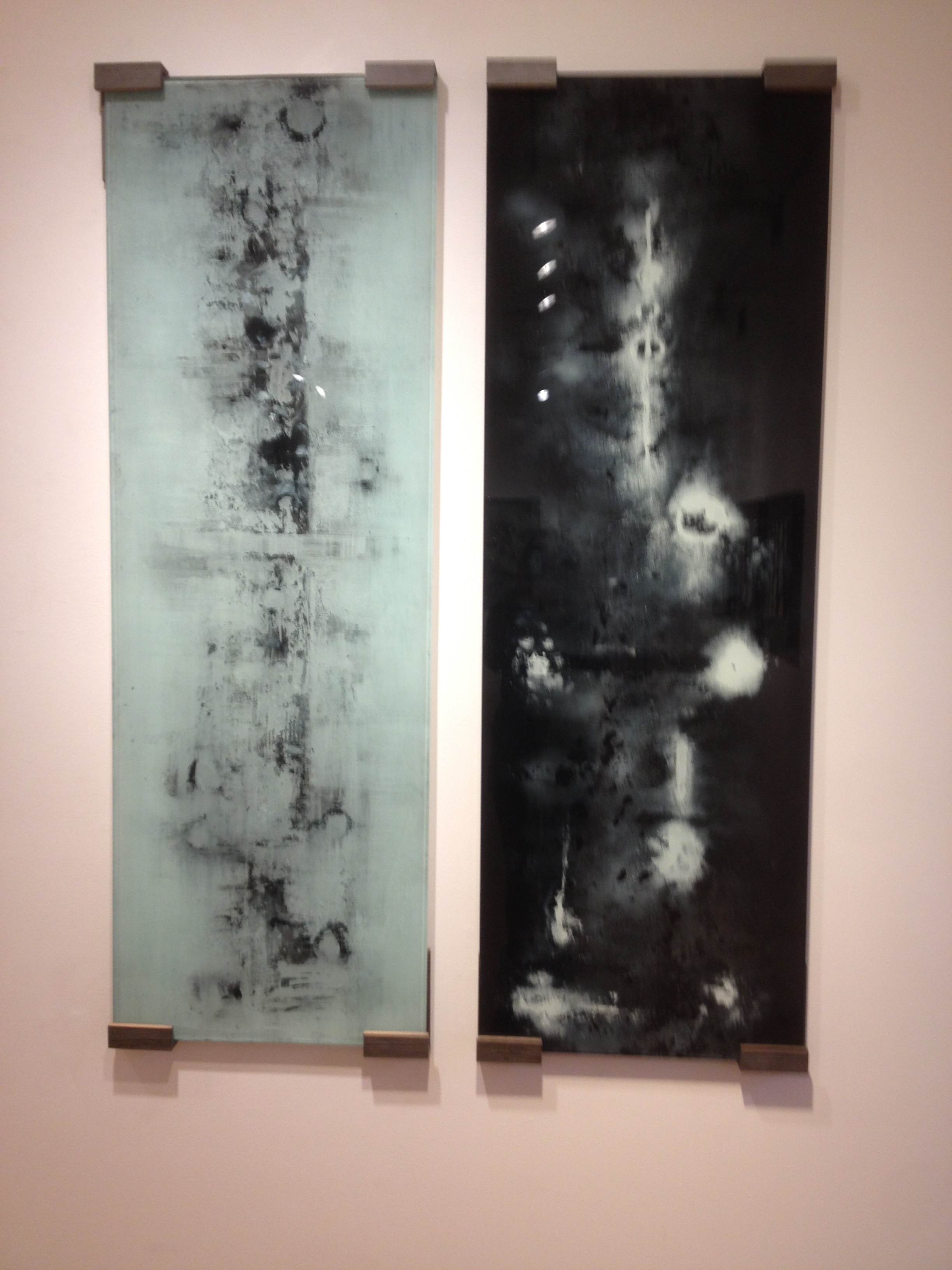 "Black and White mixed medium glass paintings both 58"" x 20"""