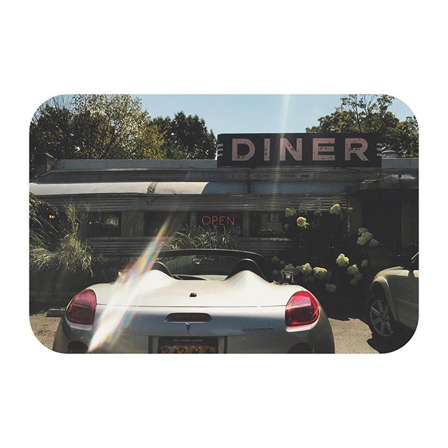 Concept cars at roadside diners. Neon lights reflected in hot coffee. Only the future may visit the past. · · · #crackedlens #visions #roadsidediner #convertible #greasyspoon
