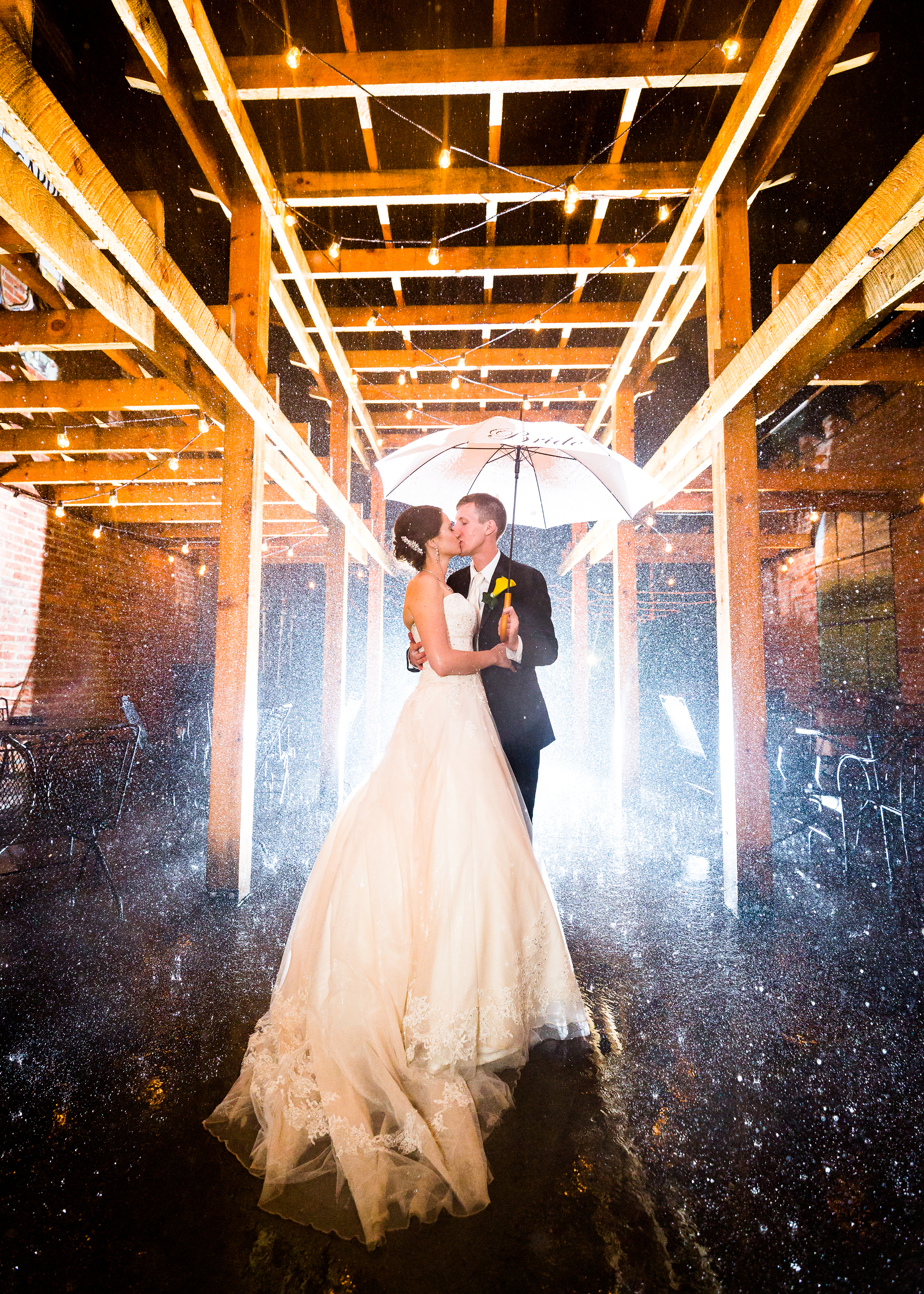 "Emily & Kyle - ""…he is absolutely dedicated to his work and I could not find any better words to describe him that devoted, driven, and the best damn photographer that I have ever met!""Full Review:""Eric did such an amazing job at our wedding a couple weeks ago, and even the process leading up to the big day! The night before the wedding he called me to let me know that although the weather forecast looked rainy, not to let that bother me because he could capture some amazing rain shots if necessary- and if you saw that great shot from two weeks ago in the rain- he was absolutely right! Eric went above and beyond to ensure that all of my guests and wedding party members were captured with photographs, took so many action shots dancing, romantic shots on the rooftop of Browns as well as in the rain (getting soaked in the process)...he is absolutely dedicated to his work and I could not find any better words to describe him that devoted, driven, and the best damn photographer that I have ever met! Eric has made this entire process enjoyable through creating timelines, being flexible, and even coming to the bridal salon to capture"