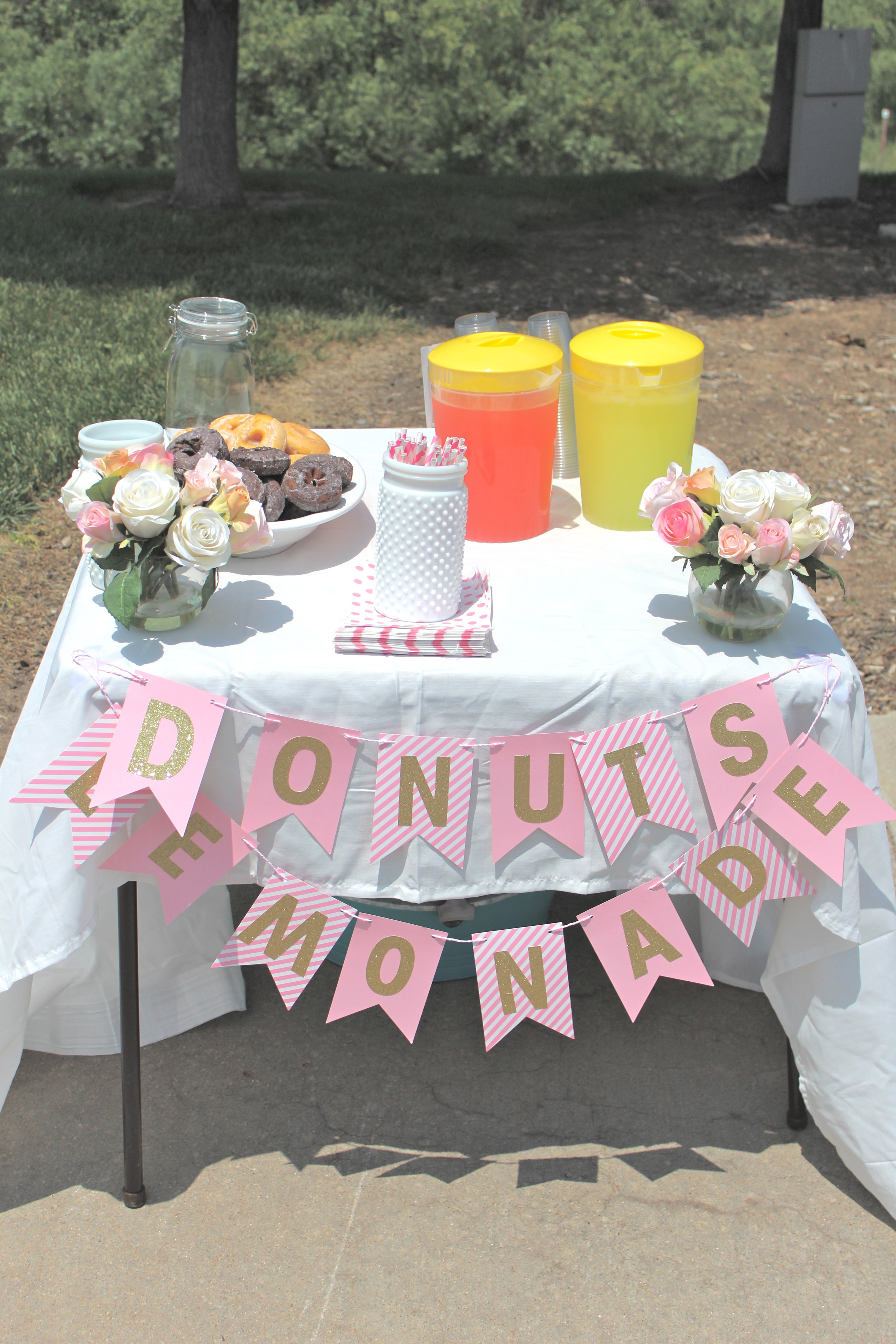 """Added donuts for the extra """"wow-factor"""" that would get the cars to stop - kids made $30 this day!"""